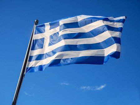 Greek flag waving in blue sky in Greece Stockfoto