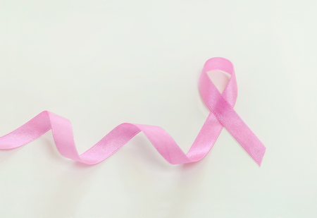 Breast cancer concept, pink ribbon on background