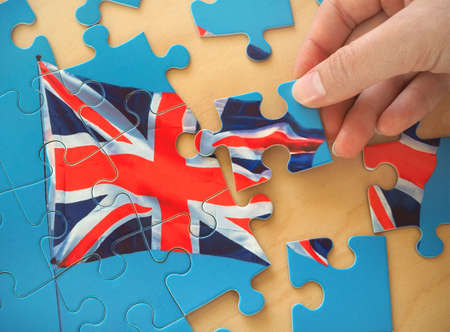 Puzzle with Great Britain flag. Brexit concept Фото со стока