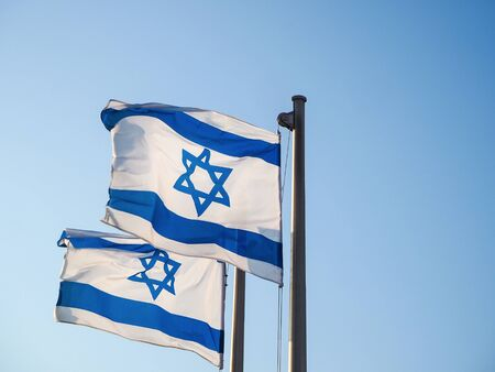 National flag of Israel outdoors against the sky