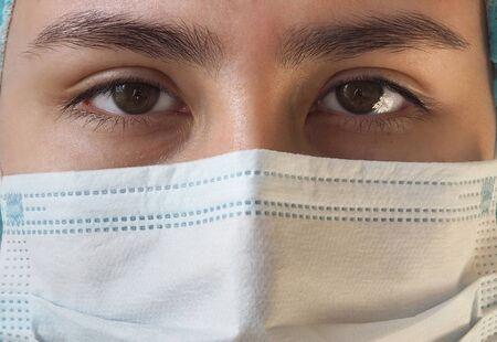 Nurse wearing protection face mask against coronavirus