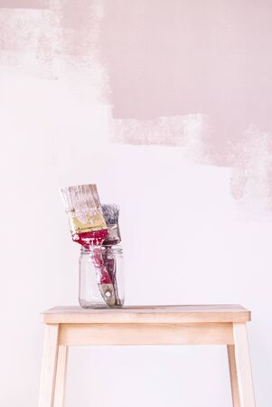 Painting equipment, paintbrushes with a pink background