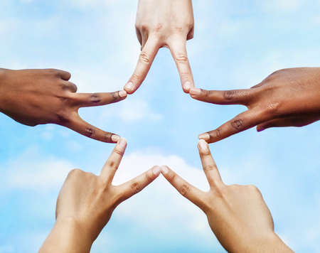 Black and white people forming five pointed star with their fingers.