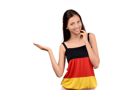 Beautiful girl presenting. Attractive girl with Germany flag blouse. Isolated on white. photo