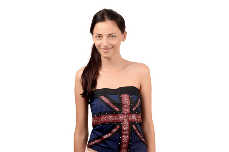 english girl: Portrait of a beautiful English girl smiling. Attractive girl with UK flag on her top. Isolated on white.