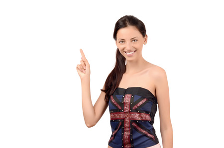 english girl: Beautiful English girl pointing up. Attractive girl with UK flag on her top. Isolated on white.
