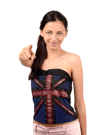 english girl: Beautiful English girl pointing in front to you. Attractive girl with UK flag on her top. Focus on the hand, blur on the model. Isolated on white.