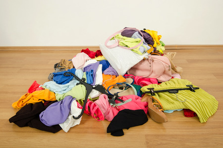 Close up on a big pile of clothes and accessories thrown on the ground  photo