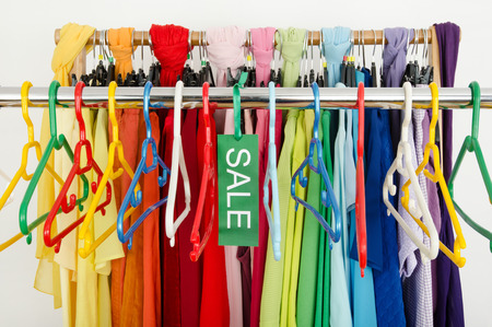 clothes rack: Empty rack of clothes and hangers after a big sale  Sale sign for summer clothes