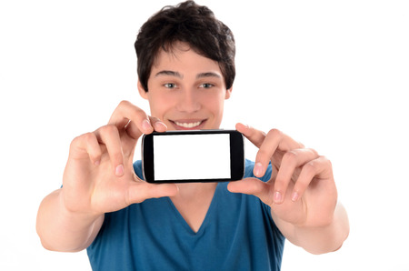 Happy young man taking a selfie photo with his smart phone  Man smiling looking at his mobile phone   photo
