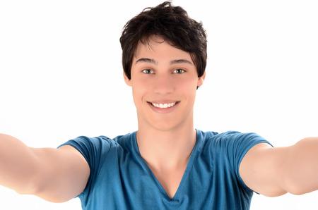 retratos: Hombre sonriente con las manos llegando Feliz el hombre joven de tomar una foto selfie Foto de archivo