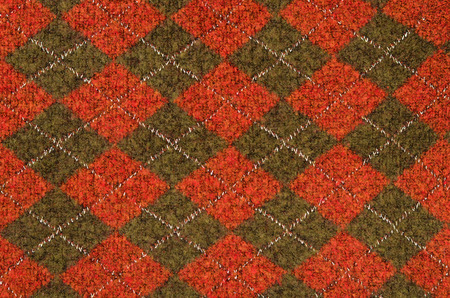red plaid: Tartan pattern. Green with red and plaid print as background. Asymmetric rhombus pattern.