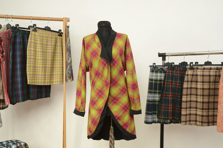 Colorful wardrobe with tartan clothes and accessories.
