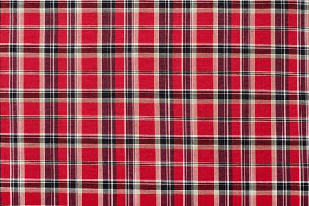 red plaid: Scottish tartan pattern. Red and black plaid print as background. Symmetric square pattern.