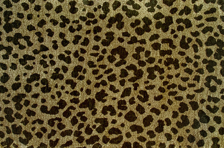 Brown leopard pattern. Spotted animal print as background.