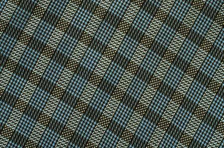 asymmetric: Tartan pattern. Blue and brown plaid print as background. Asymmetric square pattern.
