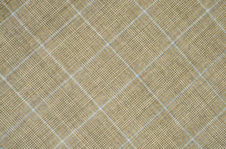 Brown and blue guncheck pattern on fabric. Rhombus tartan design as background. photo