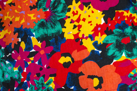 Big floral pattern on fabric. All colors flowers print as background.