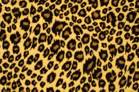 茶色のヒョウの毛皮のパターン。背景としては、アニマル プリントを発見しました。 写真素材