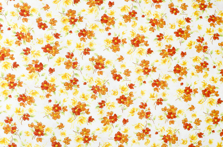 small flower: Small floral pattern on fabric. Red, orange and white flowers print as background. Stock Photo