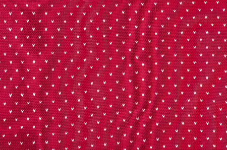 close knit: Close up on red and white dots woolen texture. Knit shapes pattern as a background. Stock Photo
