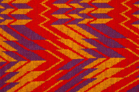 close knit: Close up on knit woolen texture. Red and purple retro woven thread as a background.