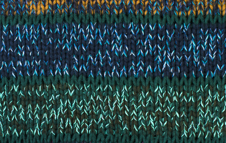 close knit: Close up on knit woolen texture. Green and blue woven thread sweater as a backgrownd. Stock Photo