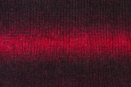 ombre: Close up on knit woolen texture. Ombre red woven thread sweater as a background. Stock Photo