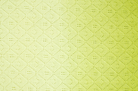 close knit: Close up on knit woolen texture. Neon yellow ombre effect woven design as a background.