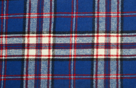 red plaid: Scottish tartan pattern. Blue with red and white wool plaid print as background. Symmetric square pattern. Stock Photo