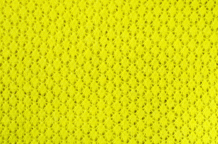 close knit: Close up on knit woolen texture. Neon yellow woven thread as a background.