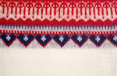 close knit: Close up on knit woolen texture. Winter shapes pattern as a background.