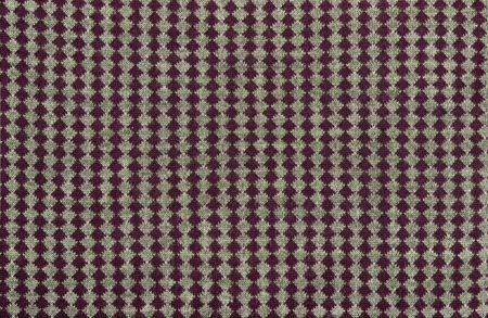 close knit: Close up on knit woolen texture. Purple line of rhombus on grey fabric as a background. Stock Photo
