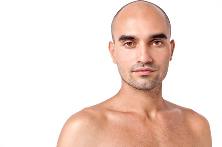 Portrait of a man. Bald Caucasian handsome man. Close up. Isolated on white. photo
