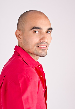 un healthy: Portrait of a man. Profile of a handsome man dressed in red shirt.