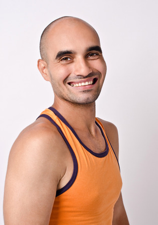 un healthy: Portrait of a man smiling. Athletic bald man laughing. Stock Photo