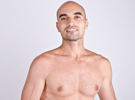 Portrait of a topless man smiling. Caucasian bald man laughing. photo