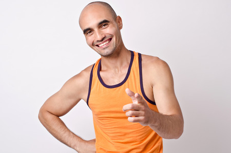 un healthy: You can do this! Muscular man smiling pointing at you. Bald man smiling.