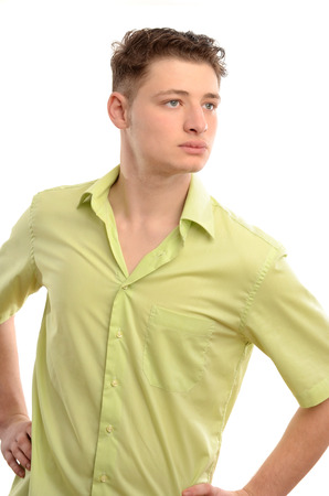 far away look: Relaxed man standing with the hands on the hips from profile looking far away