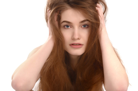 Young girl with messy long brown hair. Bad hair day. Stock fotó