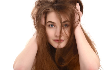 bad hair day: Young girl with messy long brown hair. Bad hair day. Stock Photo