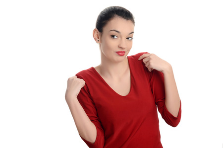 Young woman looking to the side disliking what she sees. Girl in red gesturing being confused unhappy negative. Isolated on white background. photo