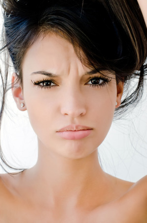 Portrait of an upset beautiful woman, Close up on girl frowning, looking unhappy and stressed. Bad hair day.