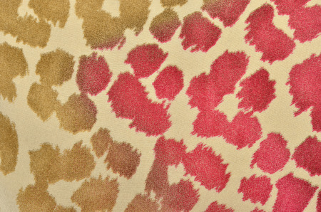 spotted fur: Brown and pink leopard fur pattern. Colorful spotted animal print as background.