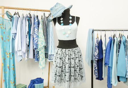 woman closet: Wardrobe full of all shades of blue clothes, shoes and accessories. Stock Photo