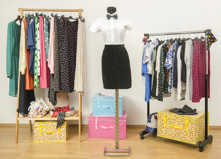White shirt with bowtie and a black skirt on a mannequin. Colorful wardrobe with clothes and accessories. Girl masculine look. Standard-Bild