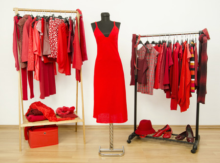 shirt hanger: Wardrobe full of all shades of red clothes, shoes and accessories.