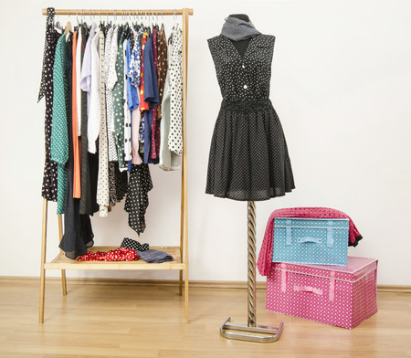 black color: Colorful wardrobe with polka dots clothes and accessories.