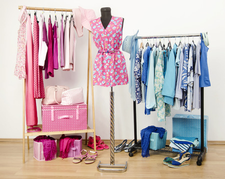 casual clothes: Dressing closet with pink and blue clothes arranged on hangers and an outfit on a mannequin. Wardrobe full of all shades of blue and pink clothes, shoes and accessories.