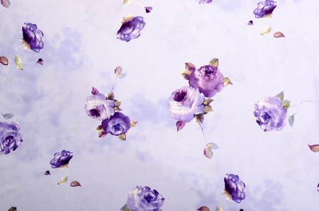 rose pattern: Floral pattern on purple fabric. Mauve rose flower print as background. Stock Photo